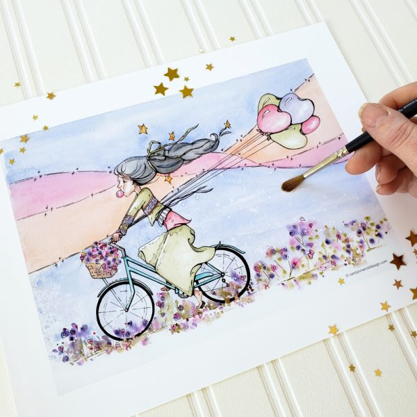 Joy Ride Print with gold stars and the artist's hand holding a paintbrush.