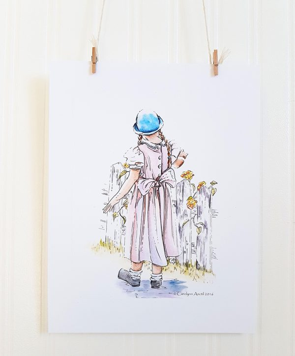 Pink Summer Dress watercolour illustration hangs suspended by 2 miniature clothespins against a white background. A young girl faces away from the camera and walks next to a white picket fence with white roses growing on it. She wears a blue hat, and pink dress.