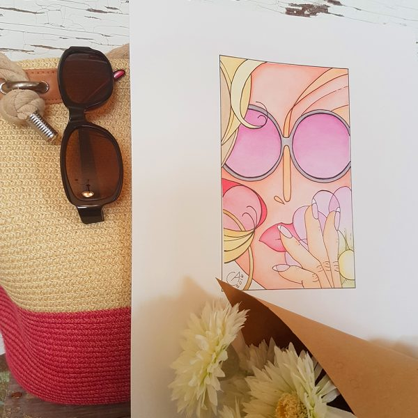 Photo of Shady Lady watercolour illustration against a pink and cream market bag. Sunglasses hang from the market bag and daisies, wrapped in brown kraft paper are in the foreground.