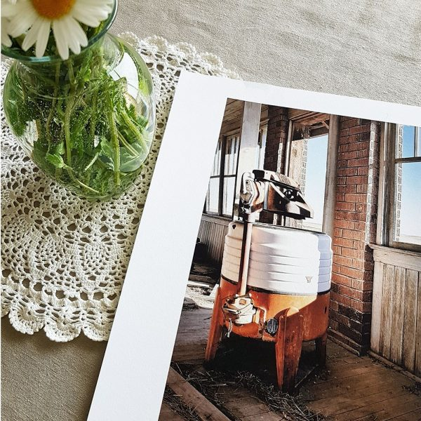 Wash Day print pictured with wild daisies in a vase.