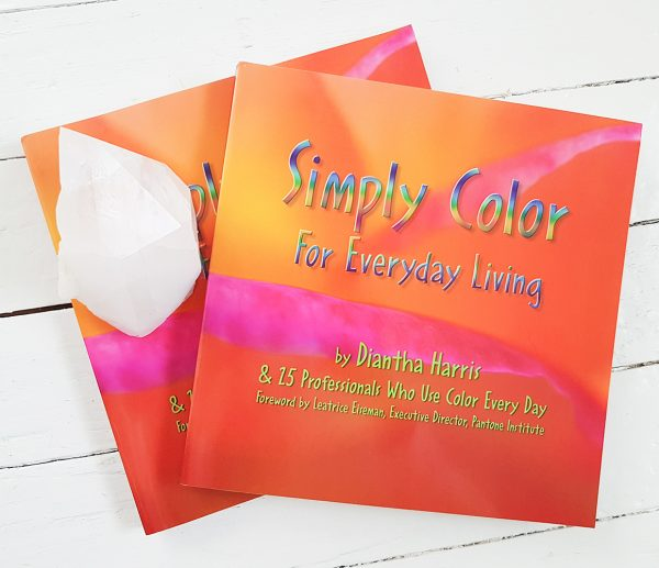 Front cover of 2 Simply Color for Everyday Living book by Diantha Harris set against a whitewashed wood background.