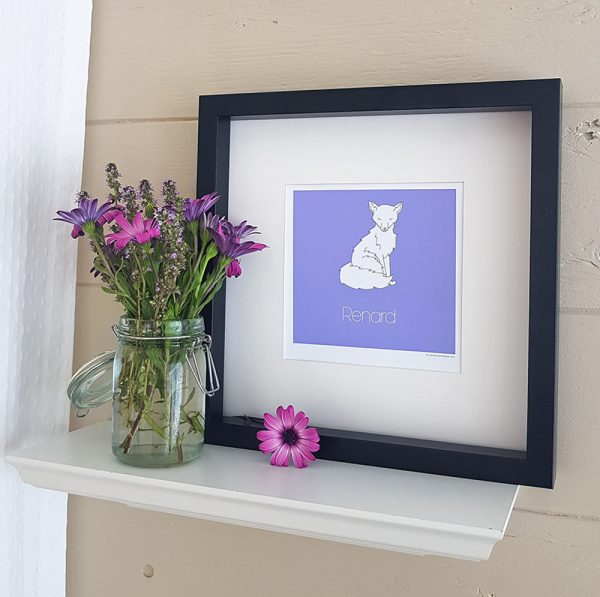 Photo of purple Renard/Fox watercolour illustration in a black frame atop a white shelf. A bouquet of pink and purple wildflowers set in a canning jar vase sit to the left of the frame. The background wall is taupe.