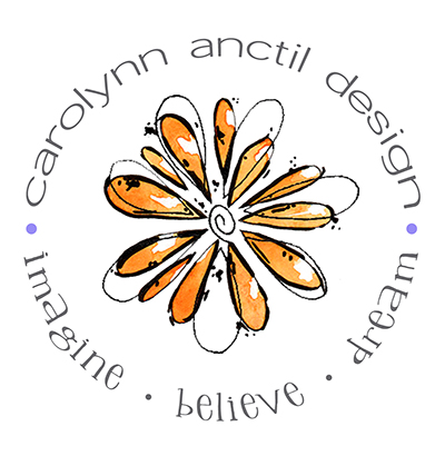 Carolynn Anctil Design logo. Freehand black in drawing of a flower in white and orange. A circular frame comprised of the following words surround the central flower. Carolynn Anctil Design, Imagine, Believe, Dream.