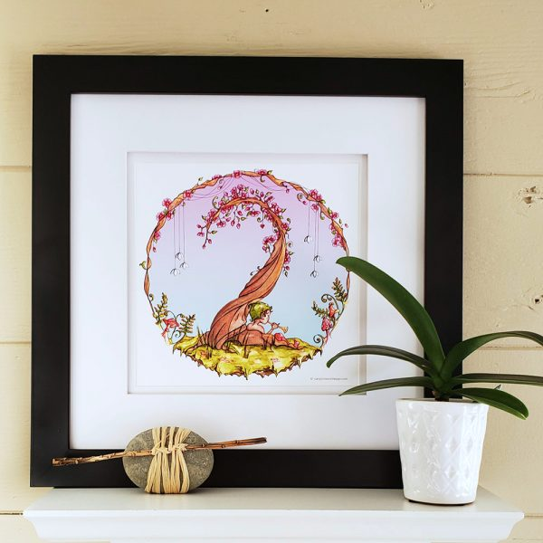 Dreamer print in black frame on white shelf with a potted plant and raffia wrapped stone.