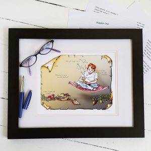 The Reader print framed and pictured with glasses and a fountain pen.