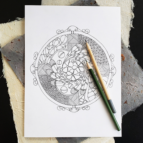 Zentangle colouring book page pictured with 2 coloured pencils.